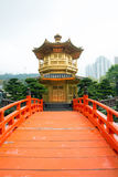 The Golden pavilion and red bridge in Nan Lian Garden near Chi Lin Nunnery, Hong Kong Royalty Free Stock Photo