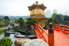 The Golden pavilion and red bridge in Nan Lian Garden near Chi Lin Nunnery, Hong Kong Stock Image