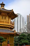 Golden pavilion with skyscrapers in Nan Lian Garden, Hong Kong royalty free stock photography
