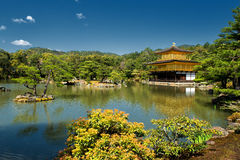 The Golden Pavilion Temple. Kinkaku-ji or the Golden Pavilion Temple in Kyoto on a sunny spring day. The Golden Pavilion is one of 17 UNESCO World Heritage sites Royalty Free Stock Photo