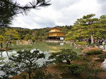 Golden Pavillion (Kinkaku-ji Temple), Kyoto, Japan. The Golden Pavillion (Kinkaku-ji Temple), with its upper two floors completely covered in gold leaf, and the Royalty Free Stock Images