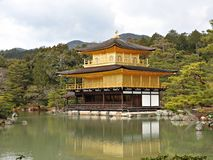 Golden Pavillion (Kinkaku-ji Temple), Kyoto, Japan. The Golden Pavillion (Kinkaku-ji Temple), with its upper two floors completely covered in gold leaf, and the Royalty Free Stock Photography