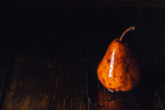 Golden Pear with Drops on Table Royalty Free Stock Photos