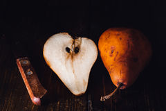Golden Pear and Knife Stock Photography