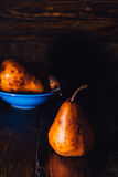 Golden Pear and Some on Background Royalty Free Stock Photography