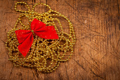 Golden pearl with red ribbon Royalty Free Stock Image