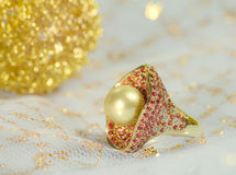 Golden pearl ring Stock Photo