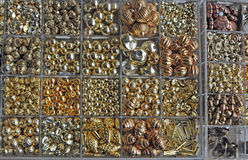 Golden pearls and beads Stock Photo