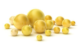 Golden pearls on a white. Royalty Free Stock Photography