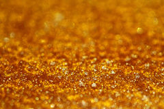 Golden pearly glitter sparkles background. With focus line , super macro shot, shallow DOF Royalty Free Stock Photos