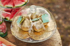Golden pears in a glass plate. Wedding decoration. Dessert table whith fresh golden fruits outdoors Royalty Free Stock Photography