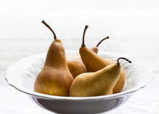 Golden pears in white porcelain bowl Stock Photography