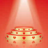 Golden pedestal with red hearts and scene lighting. Royalty Free Stock Photo
