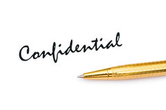Golden pen and confidential Royalty Free Stock Image
