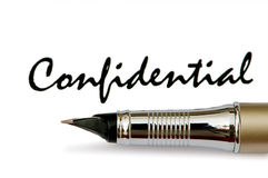 Golden pen and confidential message Royalty Free Stock Photos