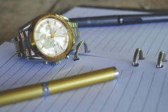 Golden Pen on Note Book Royalty Free Stock Image