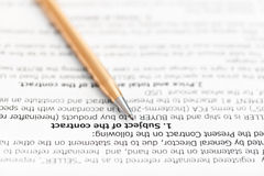 Golden pen on page of sales agreement Stock Photo