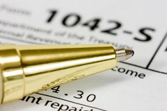 Golden pen on the  tax form Royalty Free Stock Image