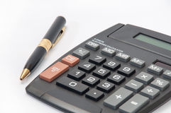 Golden pencil and a calculator on a white background Royalty Free Stock Photos