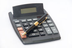 Golden pencil and a calculator on a white background Royalty Free Stock Image