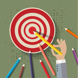 Golden pencil hit the target with hand Stock Image