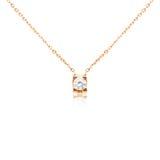 Golden pendant isolated on white. Background Royalty Free Stock Photos