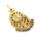 Golden pendant with stones Royalty Free Stock Images