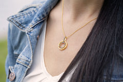 Golden pendant Royalty Free Stock Image