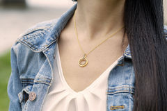 Golden pendant Royalty Free Stock Images