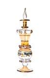 Golden perfume bottle Royalty Free Stock Photo
