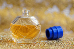 Golden perfume bottle Stock Image