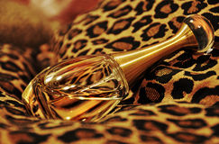 Golden perfume bottle sexy animal print cushion Royalty Free Stock Photo