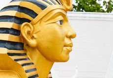 Golden pharaoh statue Stock Image