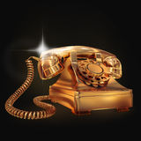 Golden phone on black background. Royalty Free Stock Image