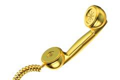 Golden phone handset Royalty Free Stock Image