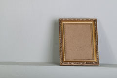 Golden photo frame with space Royalty Free Stock Photos