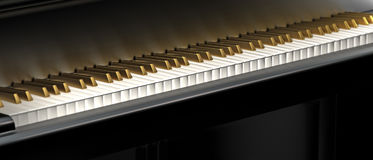 Golden piano keyboard. Music background image with golden piano keyboard Stock Photography