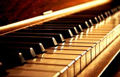 Golden Piano Keys. Golden keys of a piano royalty free stock photo