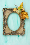 Golden picture frame autumn leaves blue background Stock Photo