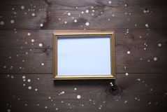 Golden Picture Frame With Copy Space And Snowflakes Royalty Free Stock Image