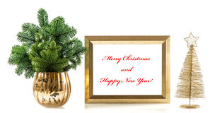 Golden picture frame with decoration and christmas tree branches Stock Photo