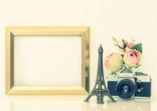 Golden picture frame, flowers and vintage camera. Nostalgic deco Royalty Free Stock Photo