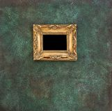 Golden picture frame grungy wall background. Golden picture frame on grungy wall background stock photos