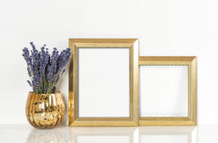 Golden picture frame and lavender flowers. Vintage style mock up