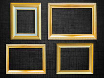 Golden picture frame over black  background Stock Photography
