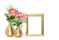 Golden picture frame pink flowers. Minimal decoration Stock Images