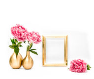 Golden picture frame pink peony flowers. Minimal decoration Stock Photography