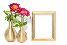 Golden picture frame pink peony flowers stock photos