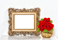 Golden picture frame red roses flowers. Vintage decoration Stock Photos