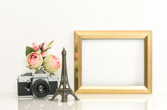 Golden picture frame, rose flowers and vintage camera. Paris tra. Golden picture frame, rose flowers and no name vintage camera. Retro style decoration with Stock Image